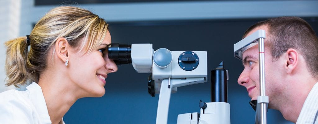 Man and woman eye exam